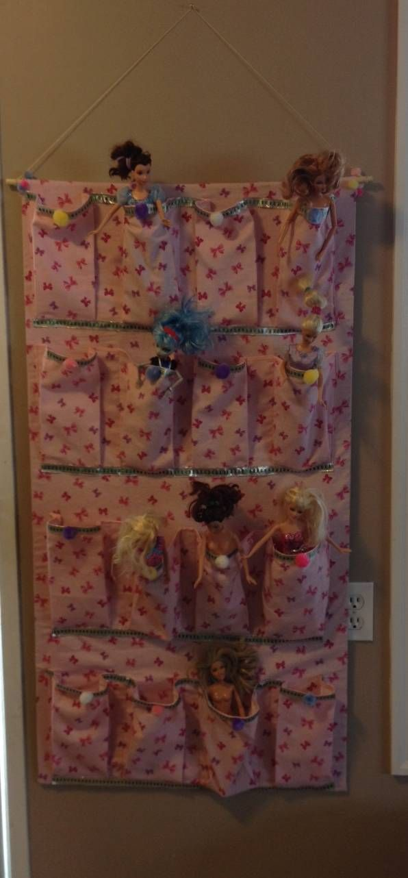 Barbie Doll Holder Made this for my granddaughter with pockets for storage for her Barbie dolls and possibly for shoes when she gets older.
