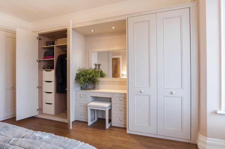 A beautiful real room which ticked all the boxes for one Hammonds customer. The classic Harpsden design suited the overall style of the customer's home. The neutral coloured walls have a hint of rose which brought out the warmth of the painted stone fitted furniture. Built in matching dressing table.