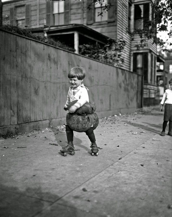 Child roller skating with pillows, c.1924