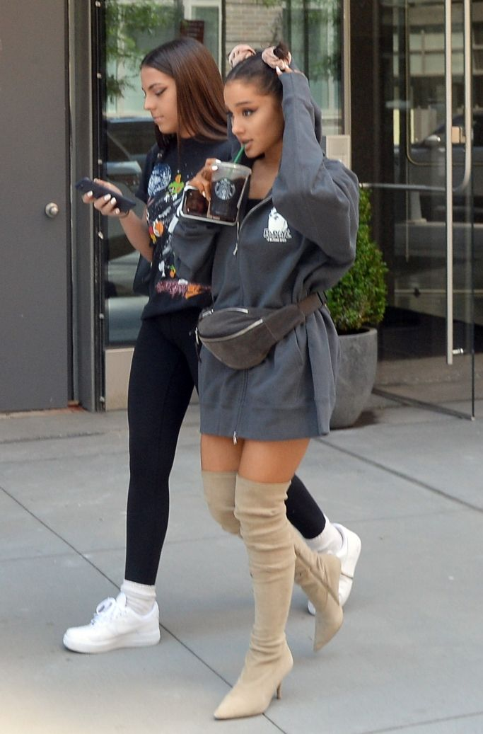 6873433e1 Ariana Grande shows pants are highly overrated with these high boots.