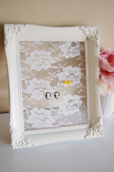 Earring storage! Get a cute vintage looking frame and some Lace-like fabric and attach it to the frame (I recommend having the lace fabric be a bit long, so you can fold it back and hot glue it to the back of the frame)