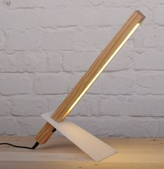 Our Handcrafted Wooden desk lamp looks more like a sculpture than a light fixture with its super thin and modern lamp design. Plus it's sliding acrylic leg for adjusting the desk lamp height. The desk lamp has 18 LEDs to make it both energy efficient and a source of crisp, clear light for reading or working. It emits the perfect concentration of warm light to focus on the work you are doing.  QUALITY LIGHTING: the desk lamp uses the LED technology to produce a great power of lumen using a…