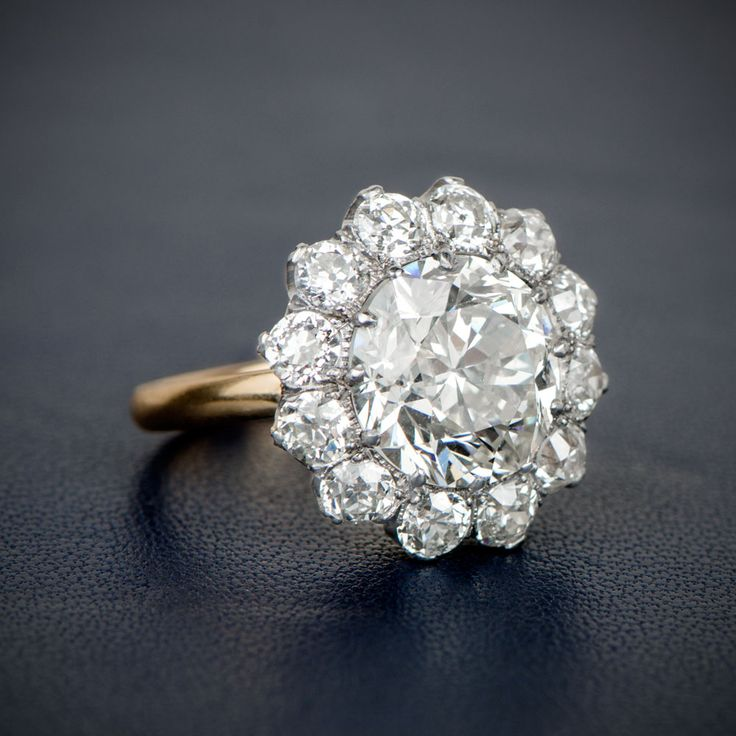 A Stunning and Rare Edwardian Era Inspired Cluster Engagement Ring, featuring an Old European Cut Diamond.