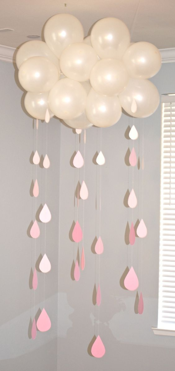 A cloud to literally shower the gift table. These were paper raindrops that we sewed together for this baby shower decor!:
