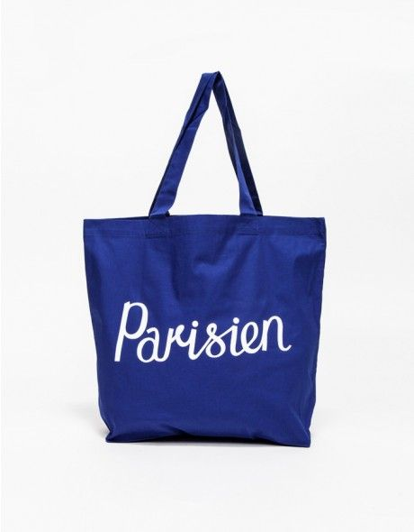 "From Maison Kitsuné, an oversized classic canvas tote bag with sturdy construction. Features durable ribbed carry handles and ""Parisien"" front graphic.  • Oversized canvas tote • Parisien front graphic • Durable construction and handles • 100% Cotton"