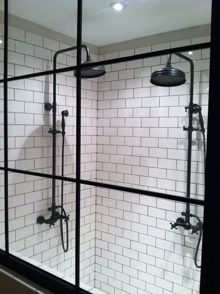 custom shower.... Warehouse window style glass, subway tile, and exposed pipe fixtures