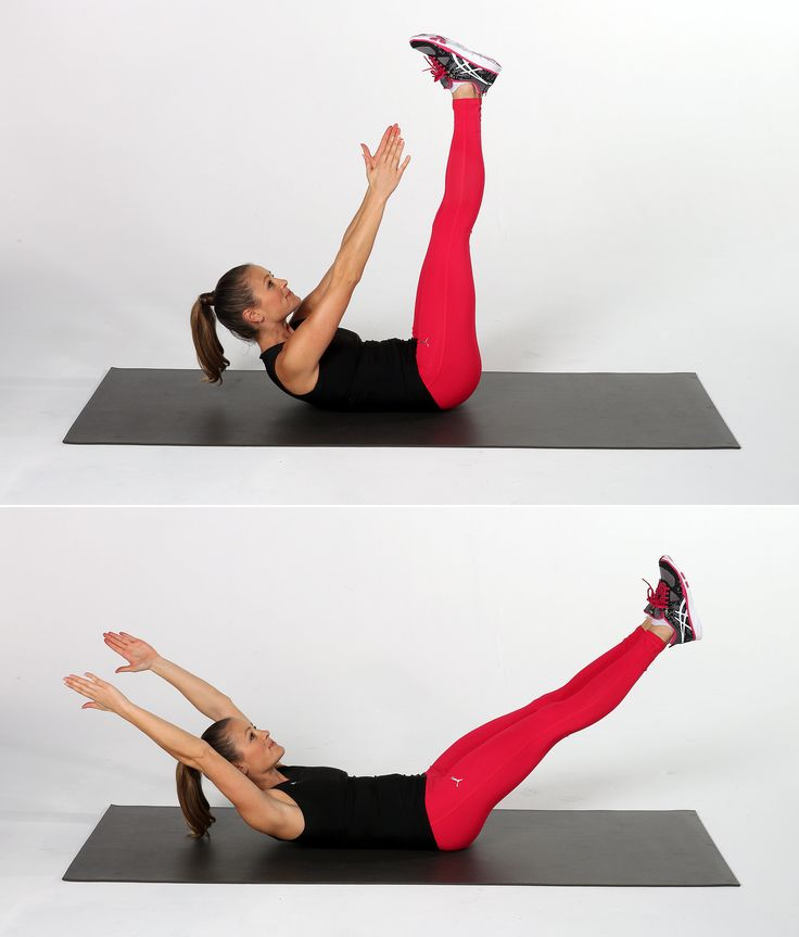 Lie on your back, and lift your legs and arms up, so they are extended toward the ceiling. Lift your upper back off the floor, reaching your hands toward your feet. Lower your legs toward the floor while reaching your arms overhead, keeping your shoulders off the mat and lower back pressed into the mat. Repeat the crunch motion to complete one rep.  Source: POPSUGAR Studios