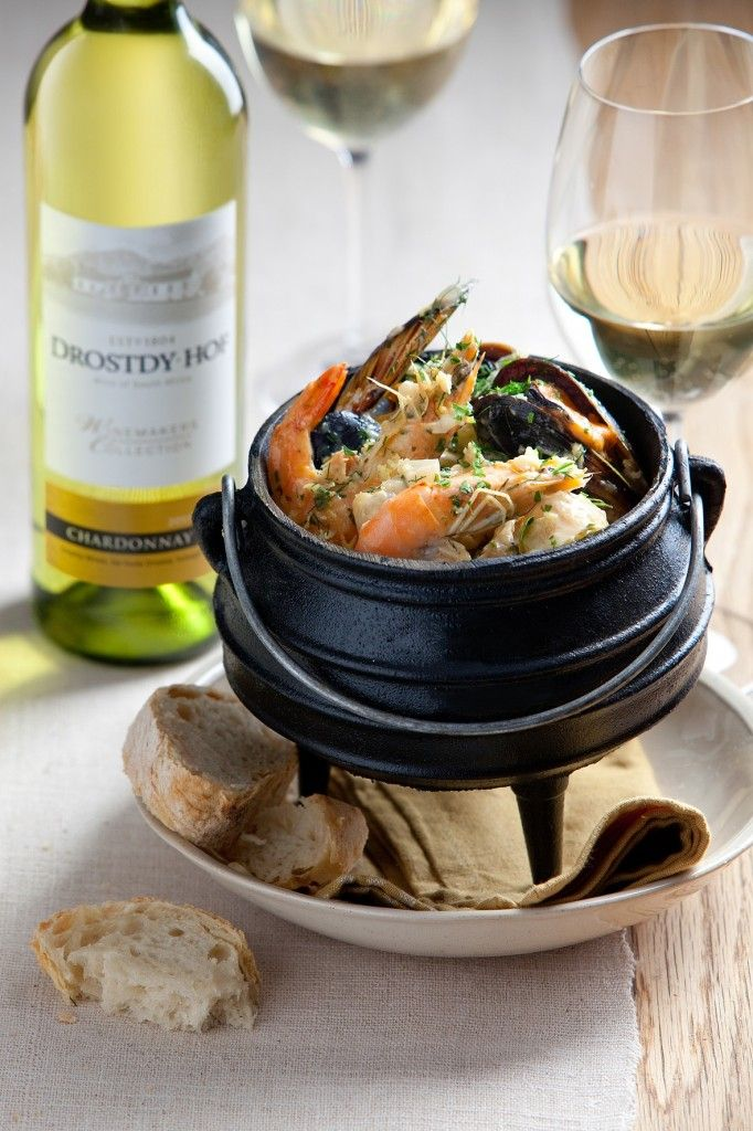 Sumptious seafood potjie, served with a chardonnay. - South Africa
