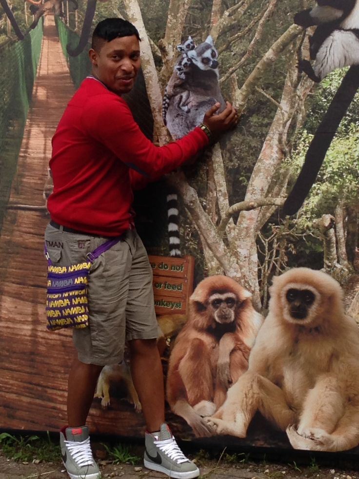 Elroy posing with his monkey friends.