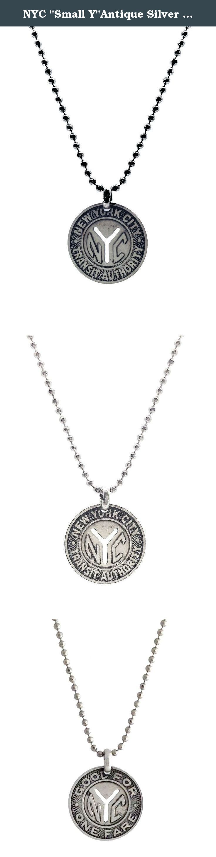 """NYC """"Small Y""""Antique Silver Plated Plated Subway Token Necklace with Ball Chain (32 Inches). The NYC subway token is the quintessential symbol of NYC. The """"Small Y"""" token was the first in a series of six tokens used in the NYC subway system and was in use between 1953 and 1970. It was the longest running token, and its design is possibly the most iconic and recognizable symbol of NYC. It measures 15mm, about the size of dime. An organic and harmonious design with every detail taken into..."""
