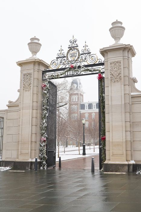 The Pi Beta Phi gate with Old Main in the background on a snowy day, Arkansas, US
