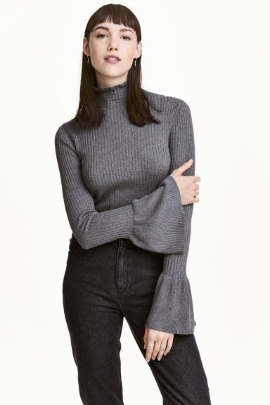 Rib-knit frilled jumper: Fitted jumper in a soft, rib-knit viscose blend with a stand-up collar with a frill trim and long sleeves with a wide flounce at the cuffs.