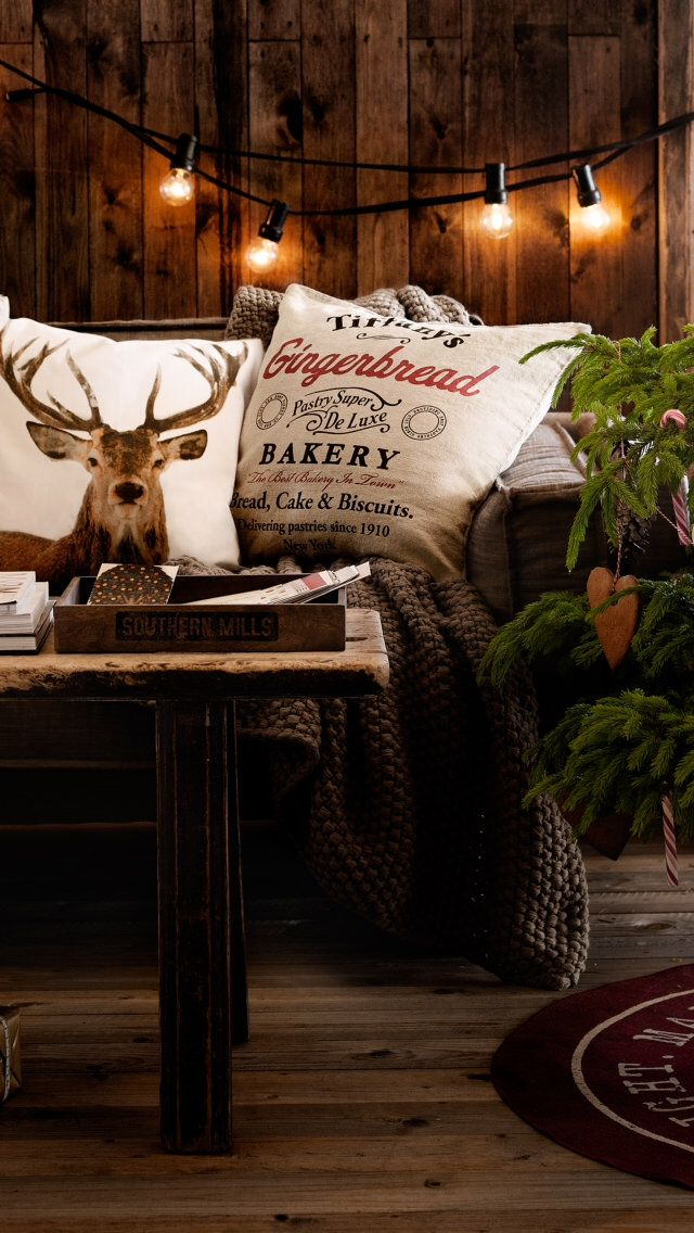 Reindeer inspired pillows with rustic Christmas decor... I love the lights against the wood wall!