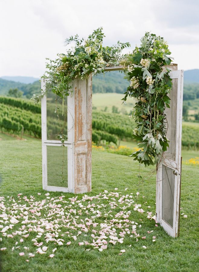 Striking the perfect blend of Southern elegance and rustic charm, this Pippin Hill affair is wedding perfection. For one, the beauty-filled backdrop is unbeatable, but when it's accentuated with Southern Blooms By Pat's Floral Design, it's simply breathtaking. Secondly, how adorable are those flower girls?! Josh Gruetzmacher has