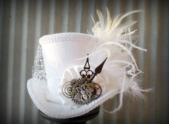 Gorgeous.  White Wedding Queen Bee Steampunk Mini Top Hat Alice by ChikiBird, $58.00
