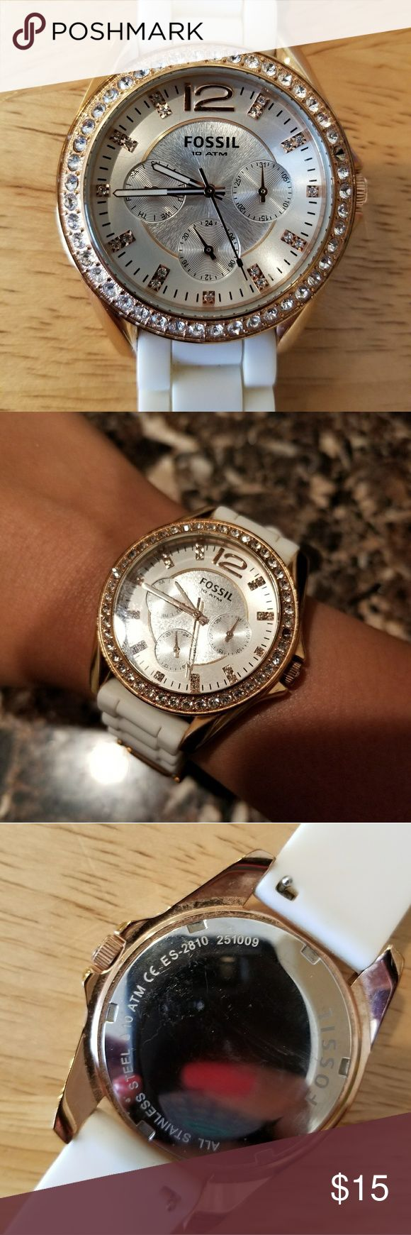 Fossil watch Rose gold and white Fossil watch. Missing 1 stone, as shown. Can be easily added (check craft stores and/or jewelry or watch repair stores.) Needs new battery. Some signs of wear but still in good condition. $15 Fossil Accessories Watches