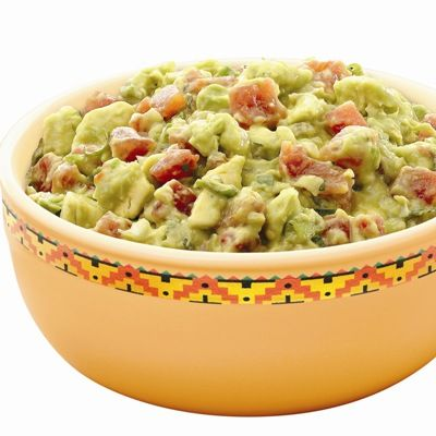 Creamy guacamole with diced, spicy tomatoes, green onion, a splash of lime juice and cilantro