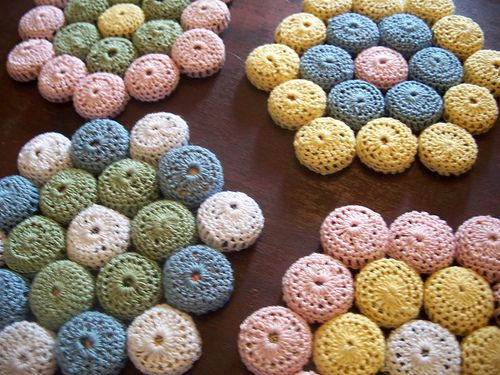 Here's the pattern - from: Dawning Dreams Blog: Bottle Cap Hot Pad Pattern