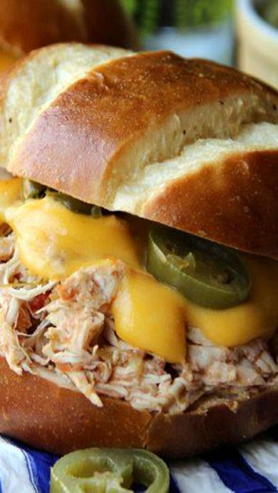 Slow Cooker Jalapeno Popper Chicken Sandwiches. I'd serve it on a pretzel roll. Yum!