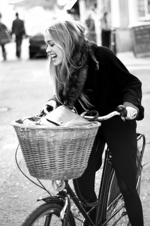 girl with a bike. bike with a basket