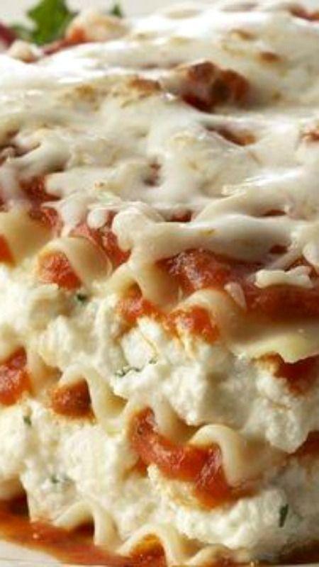 Lasagna Formaggio ~ Ricotta, mozzarella and Parmesan cheeses seasoned with Italian herbs are layered with pasta and marinara sauce.