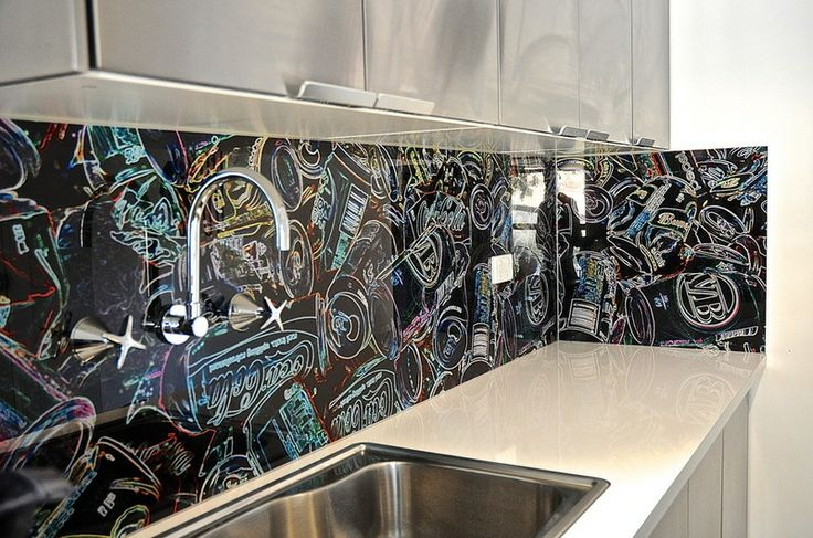 A unique custom-made backsplash. Viljoen took a photo of trash in a Dumpster and applied interesting filters to the image, then had it digit...