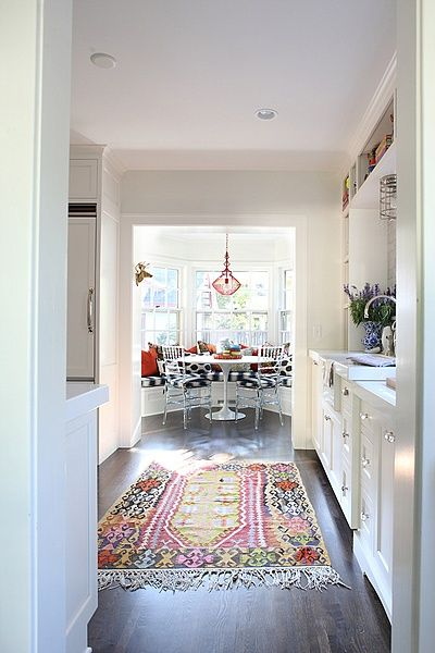 hardwood floor in galley kitchen with cool rug