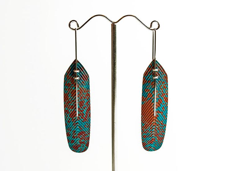 Junction Art Gallery - Earrings anodised aluminium feather, surgical steel wire stem and silver detail £80.00 www.junctionartgallery.co.uk