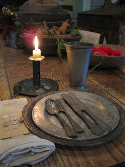 Primitive Table Setting With Pewter.