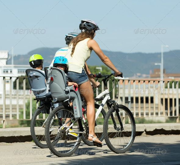 Family of four traveling by bicycles. http://photodune.net/item/family-of-four-traveling-by-bicycles/8643398?WT.oss_phrase=family%20traveling&WT.oss_rank=53&WT.z_author=JackF&WT.ac=search_thumb