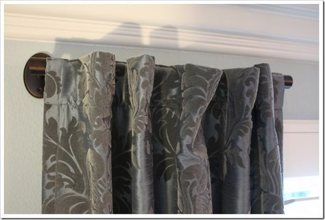 use a towel bar as a short curtain rod * short curtain rods would be good for our wall of windows in the living room