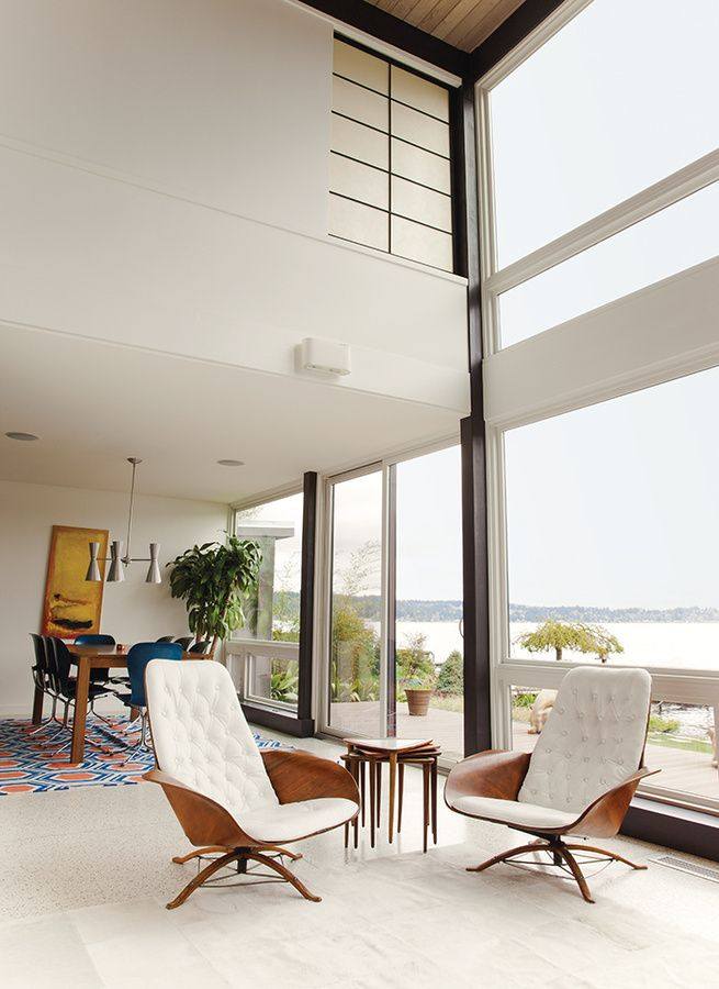 modern chairs for living room%0A Central to the living room of this Washington home is a pair of George  Mulhauser for Plycraft chairs upholstered in sleek white leather