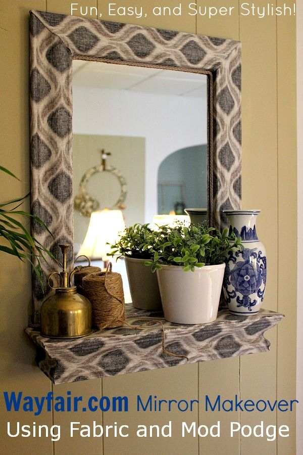a fabric and mod podge covered mirror