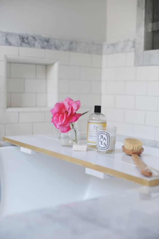Keep bath essentials (a candle, a good book) nearby when you're soaking — and add style to an empty tub when you're not. Get the tutorial at Cupcakes and Cashmere »  - GoodHousekeeping.com