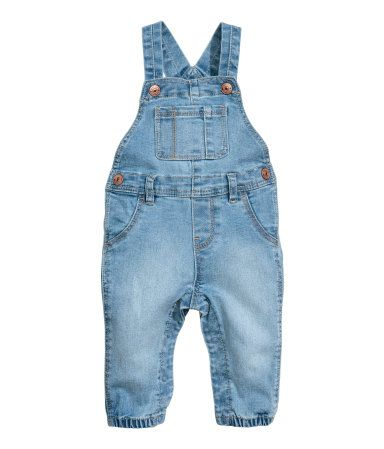 Denim blue. Bib overalls in woven fabric. Adjustable suspenders with snap fasteners, bib pocket, mock front pockets, and regular back pockets. Seam at waist