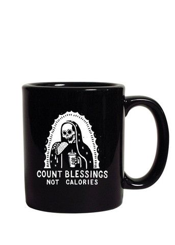"""The Count Blessings Not Calories traditional mug is made of ceramic composite and is glossy black. Each side of the high quality, c-curved handle mug is screen printed with the """"Day of the Dead"""" Virge"""