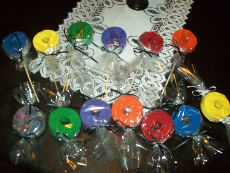 sliced pool noodles and painted them in assorted colors. Added sticks to some to make them look like lollipops. Then wrapped them in cellophane and tied with ribbon. NOT EDIBLE DECOR