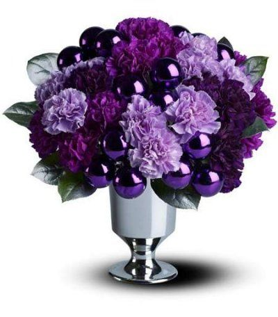a mix of lavender and purple carnations and shimmering ornaments