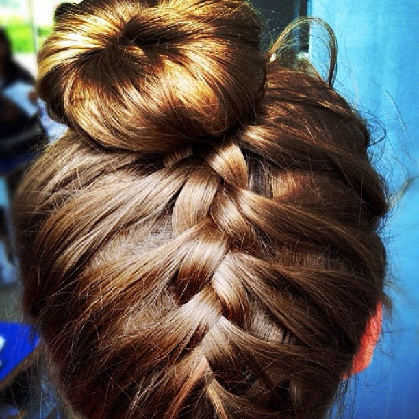 reverse french braid updo with bun. Saw tutorial on this hairstyle. Maybe I should try one day!
