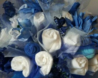 This adorable baby washcloth bouquet shows ONE DOZEN precious flowers. A washcloth bouquet makes a great baby shower gift and look sweet with diaper cupcakes at its side.  In this unique, ready to give 7 piece gift set you receive: -6- Baby washcloths (constructed to look like a dozen) -1- Handmade gift tag ready for your personal message on the back side These items come sweetly wrapped up to help spoil your mom-to-be. Information needed at checkout in the Notes to seller section: 1.Gift…