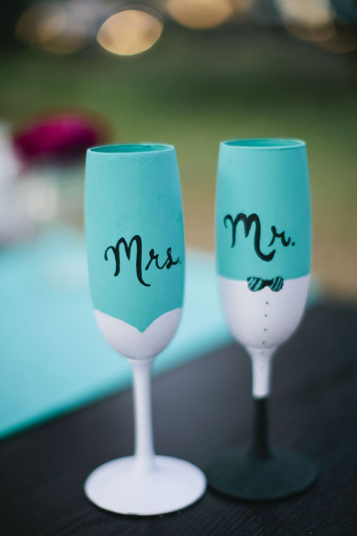 How cute are these Mr. & Mrs. champagne flutes? We love that they match the wedding colors!