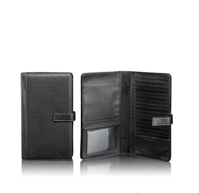 TUMI  ULTIMATE TRAVEL ORGANIZER  €179  The ultimate travel wallet. There is space for passport, ID, ticket, coin and other pockets and 17 card slots, three sections for currency and a pen holder. Made from soft, full-grain nappa leather
