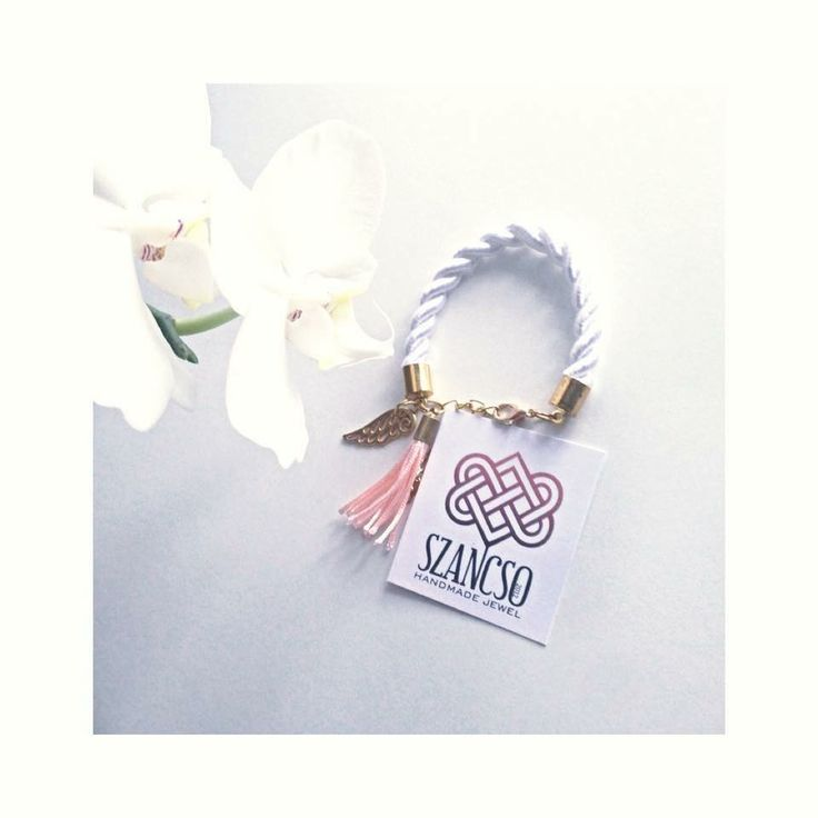 Handmade white rope bracelet with angel wing bracelet and peaches tassel