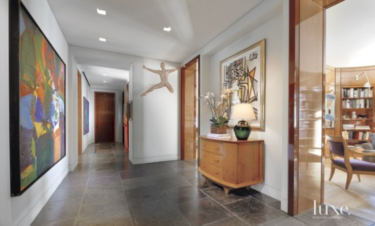 Contemporary White Hall with Gallery Walls