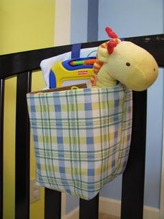 Little basket to hang on the side of a crib or toddler bed to hold toys or books to keep them content in the morning if they wake up early. This is an AWESOME idea!
