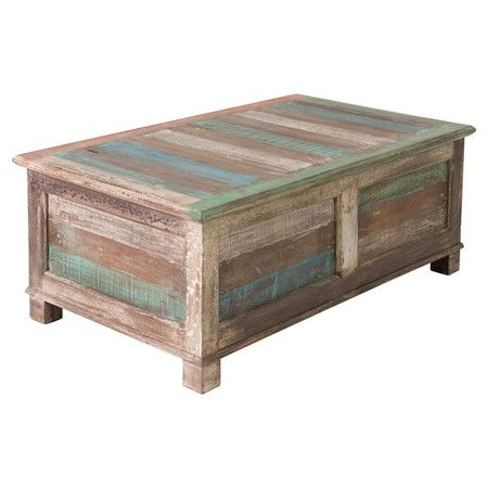Reclaimed wood trunk table with multicolor striping.   Product: Trunk tableConstruction Material: Reclaimed wood