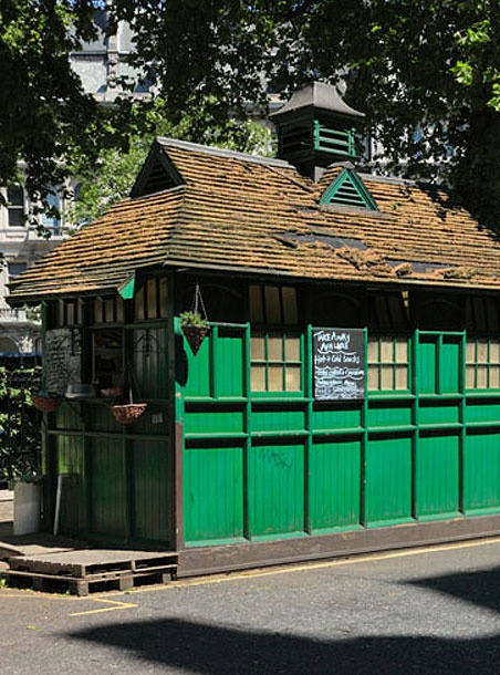 LONDON CABMAN SHELTER   LONDON   ENGLAND: *The Cabman's Shelter Fund was created by newspaper publisher Sir George Armstrong to supply drivers with a place to get out of the cold and enjoy a cheap meal without straying from the cab stand. Because the shelters stood on a public highway, the police stipulated they weren't allowed to be any larger than a horse and cart. The first shelter, erected in 1875, was located on the stand nearest his house (in Oxford St). At their peak, there were more…