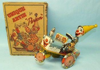 1950′s UNIQUE ART ARTIE CLOWN CRAZY CAR TIN WIND UP TOY & BOX