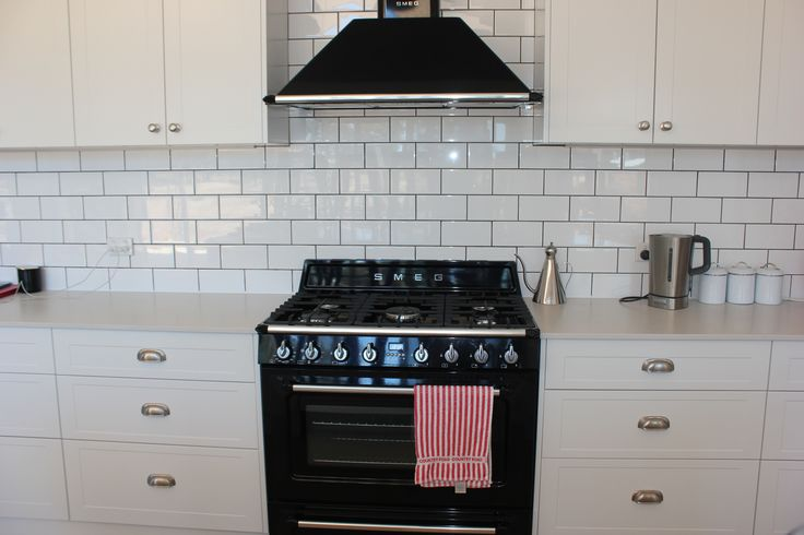 White Subway Tiles, Charcoal Grout, Black Smeg Victorian Style Oven, White Shaker Style Cabinetry