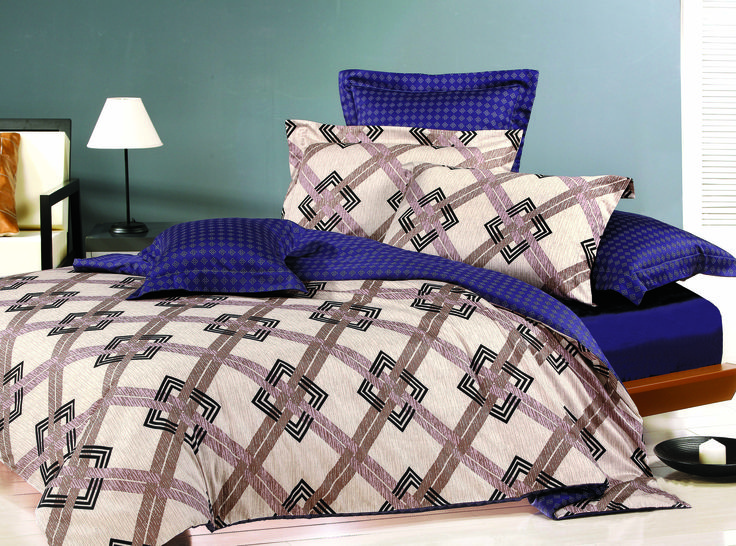 The 100% Cotton Sateen reactive print is fully reversible. The design is a bold classic pattern of oatmeal browns and blacKing and is offset with bold purple, which all complement each other.